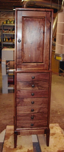 Here's a handsome walnut jewelry cabinet Ronald Frey made with help from his Woodmasters.