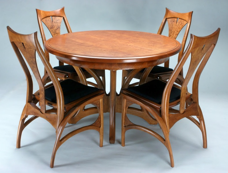 """While at the Marc Adams School of Woodworking, I was admitted into the Michael Fortune Fellowship Program. I made this one-of-a-kind table and chairs from bent laminations of quarter-sawn cherry. Following the bending process, all surfaces were sculpted to the shape you see in the photo."""