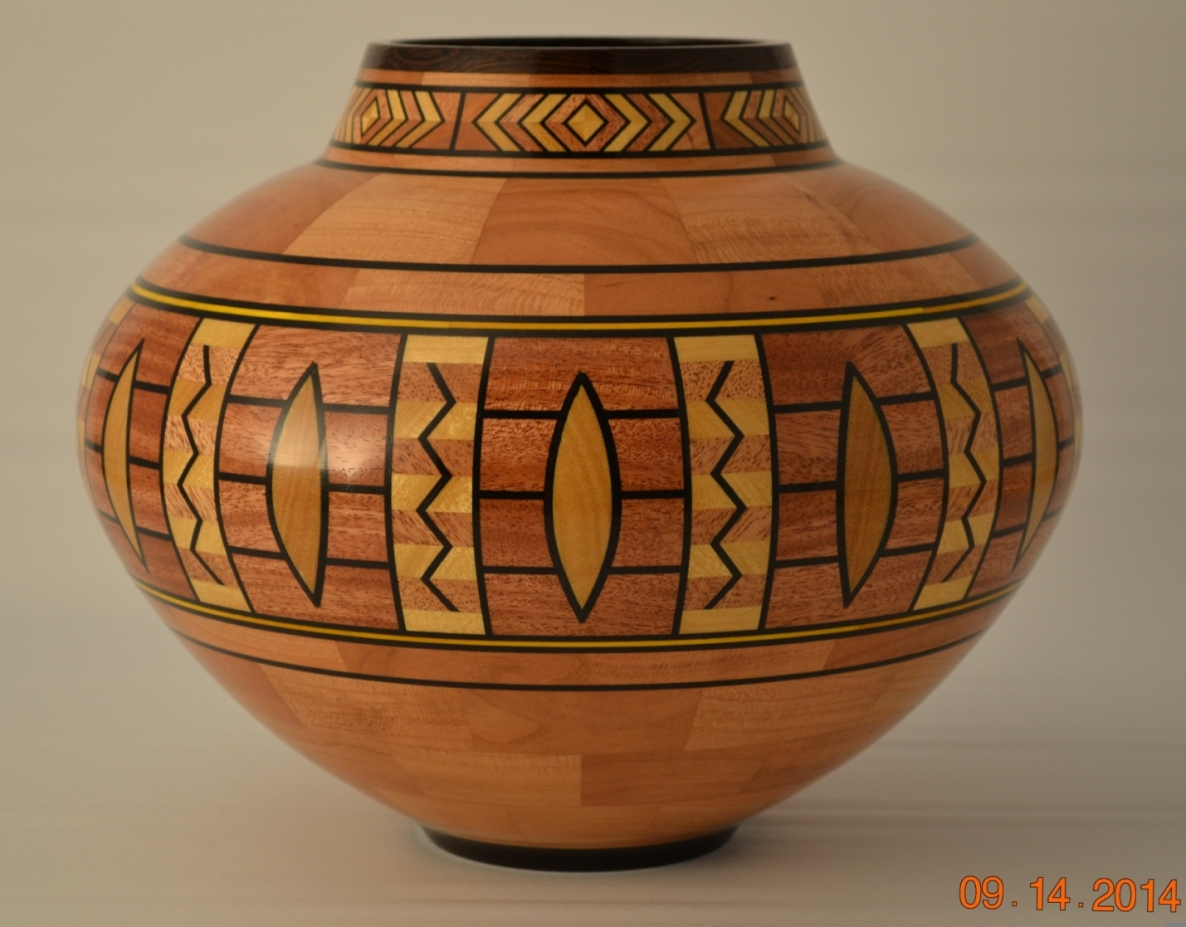Segmented woodturning is precision work so he got a woodmaster vase 11 14 diameter x 9 tall woods used cherry mahogany yellowheart wenge and dyed veneer 870 pieces of wood reviewsmspy