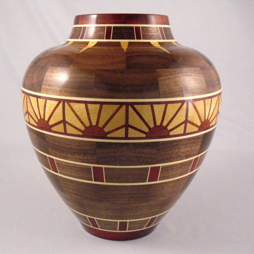 "Pete Marken's ""Rising Sun"" vase is 9-1/2"" diameter X 10-1/2"" tall - Woods used: Walnut, Yellowheart, Bloodwood and Holly. 551 pieces of wood"