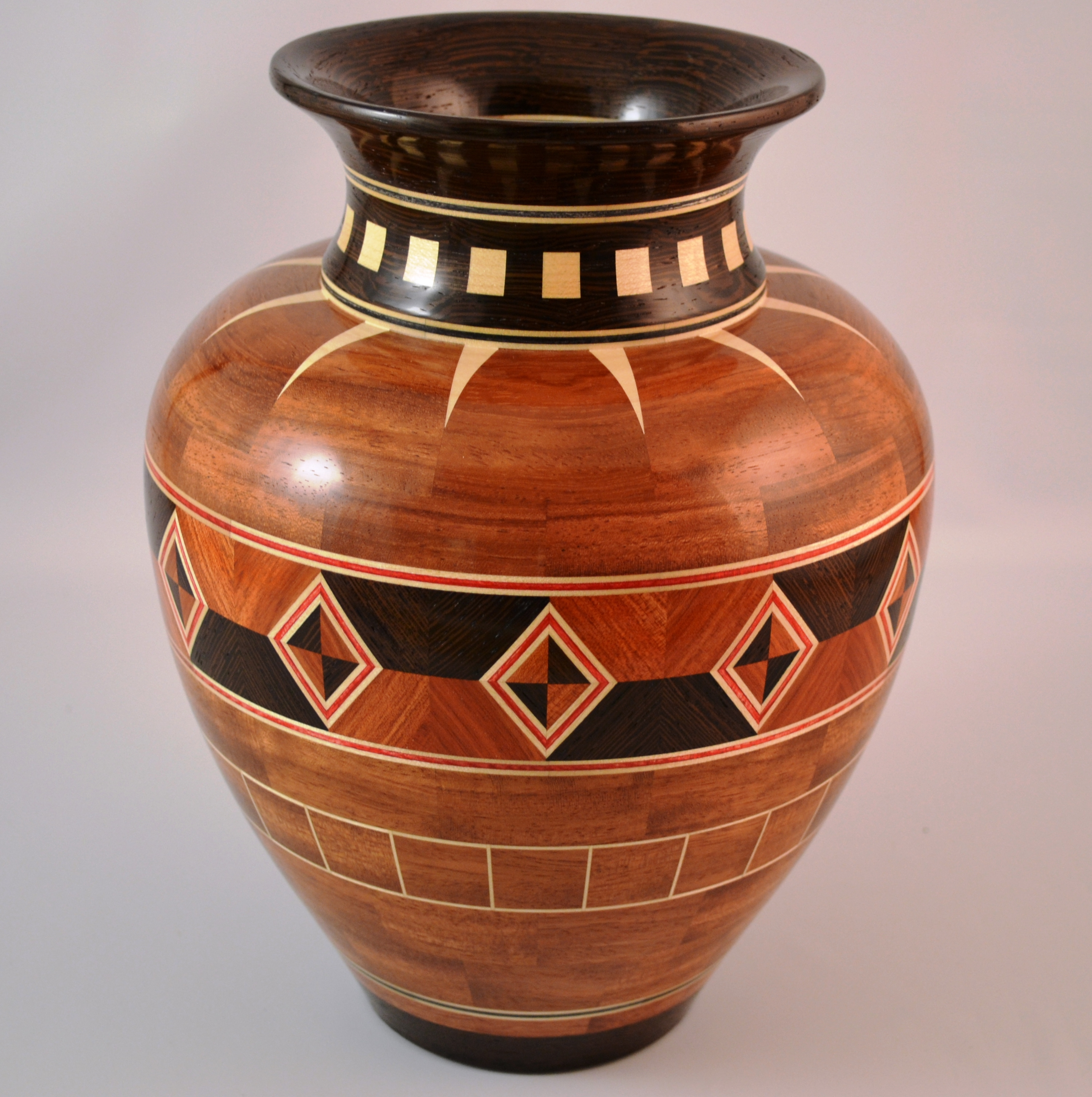 "Vase with Diamonds – 8-1/4"" diameter X 9-1/2"" tall – woods used: Bubinga, Wenge, Maple and dyed veneers – 571 pieces of wood"