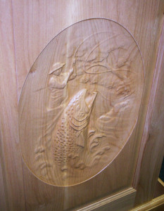 Rick built this cabinet door then did some mighty fancy bas relief carving work with his CNC routing machine.
