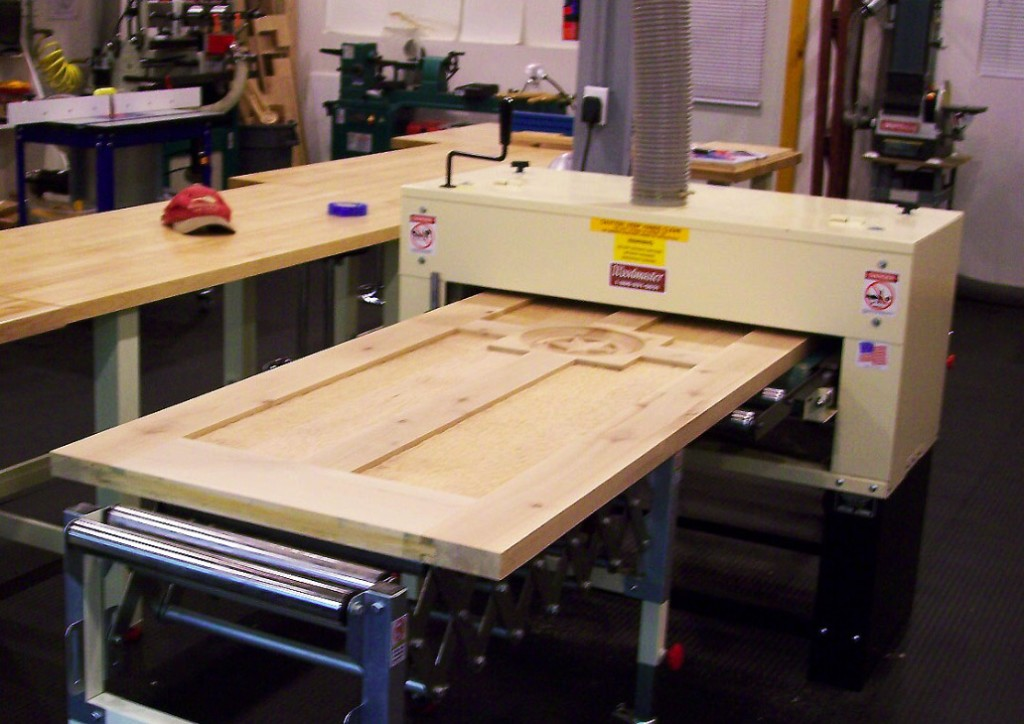"It's a mighty wide drum sander that'll swallow a full sized door whole -- 50"" wide to be exact."