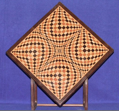 A curved-line design creates the illusion of an undulating surface in one of Mr. Westphal's creations. But it's an illusion -- the surface is flat as a board.