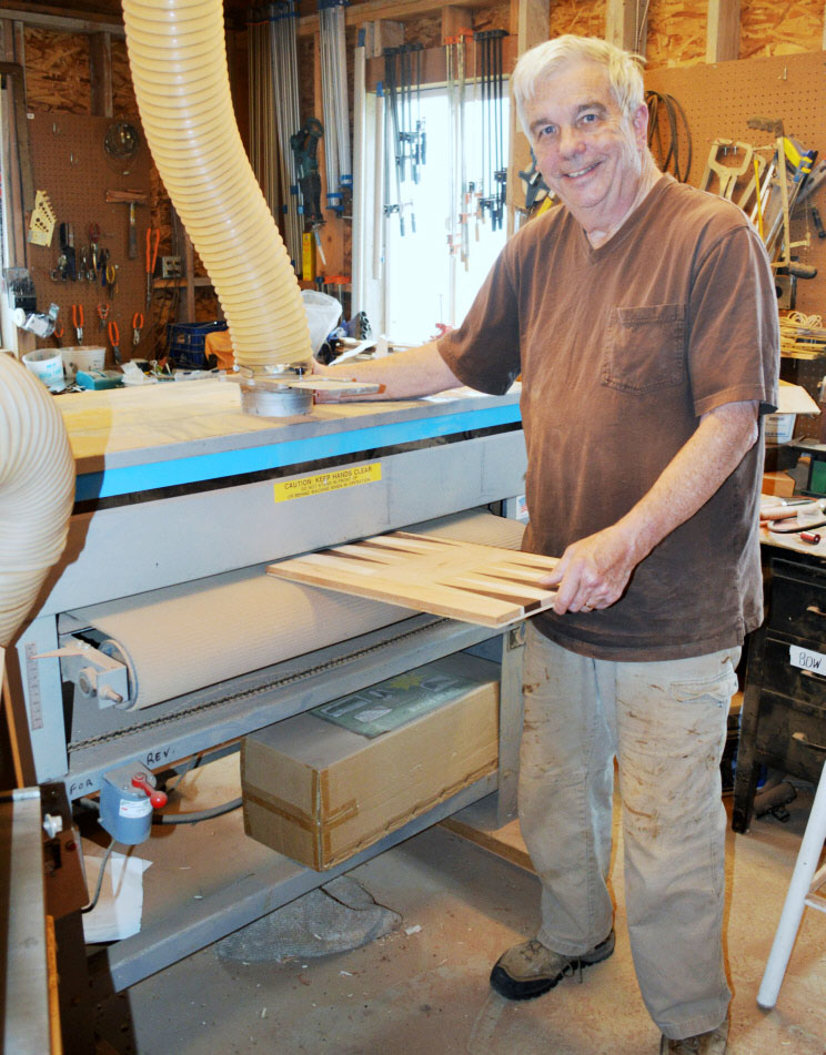 Chuck runs one of his solid wood backgammon boards through his 38% Woodmaster Drum Sander to get a perfectly smooth, even, perfect surface.