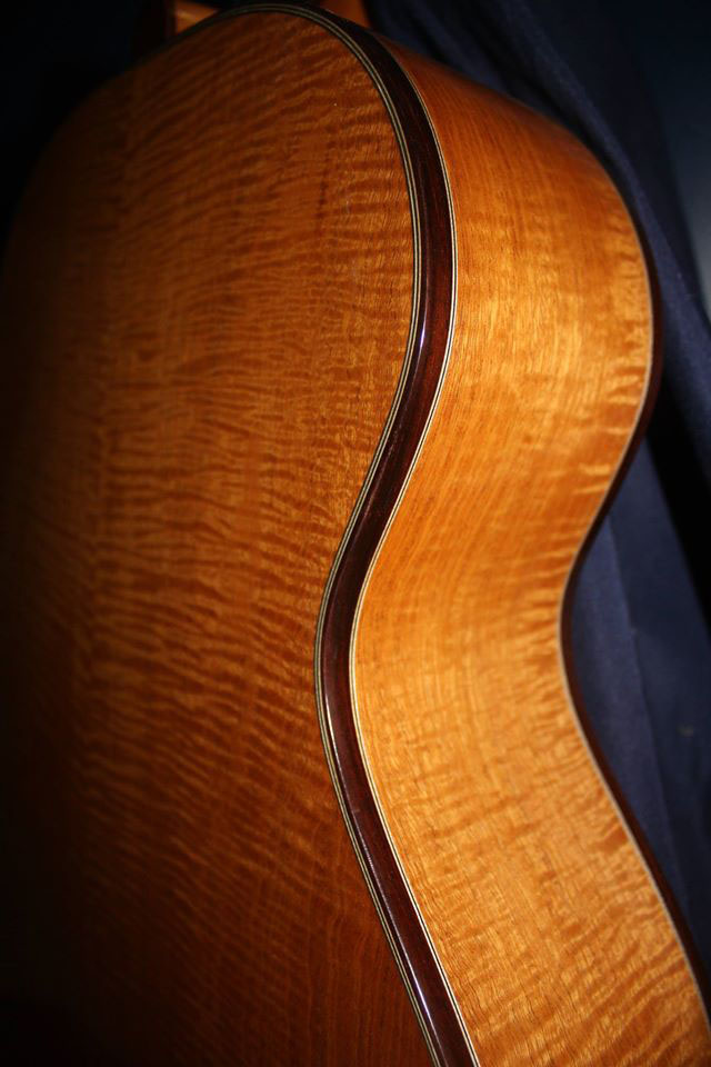 """I made this jumbo-body guitar from Flamed Honduran mahogany with rosewood binding,"" says John."