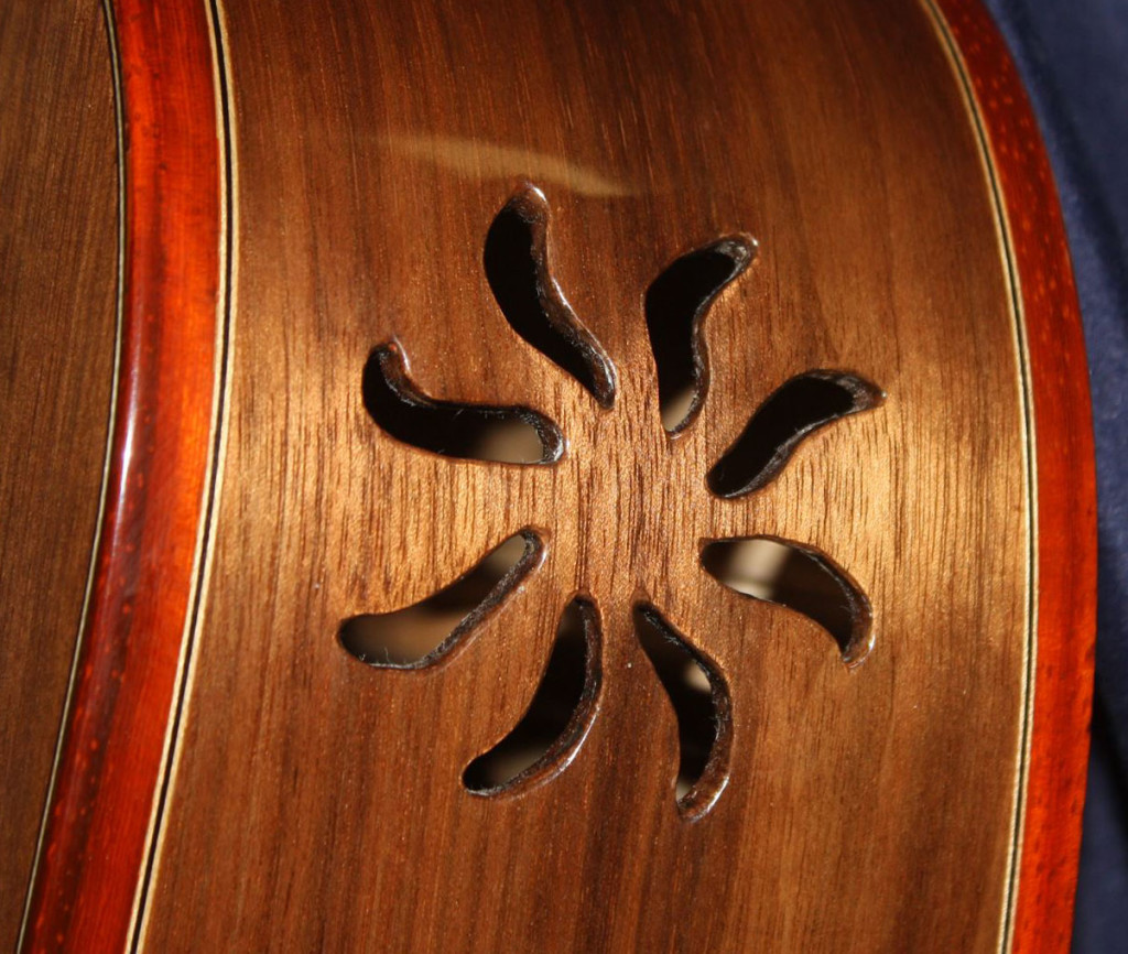 """Here's a detail of a sound port on a dreadnaught-style guitar I made of local walnut with paduk trim."""