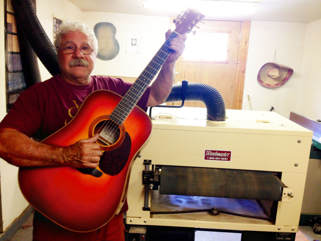 Here's John with one of many guitars he's made, and the Woodmaster Drum Sander he uses to make them.