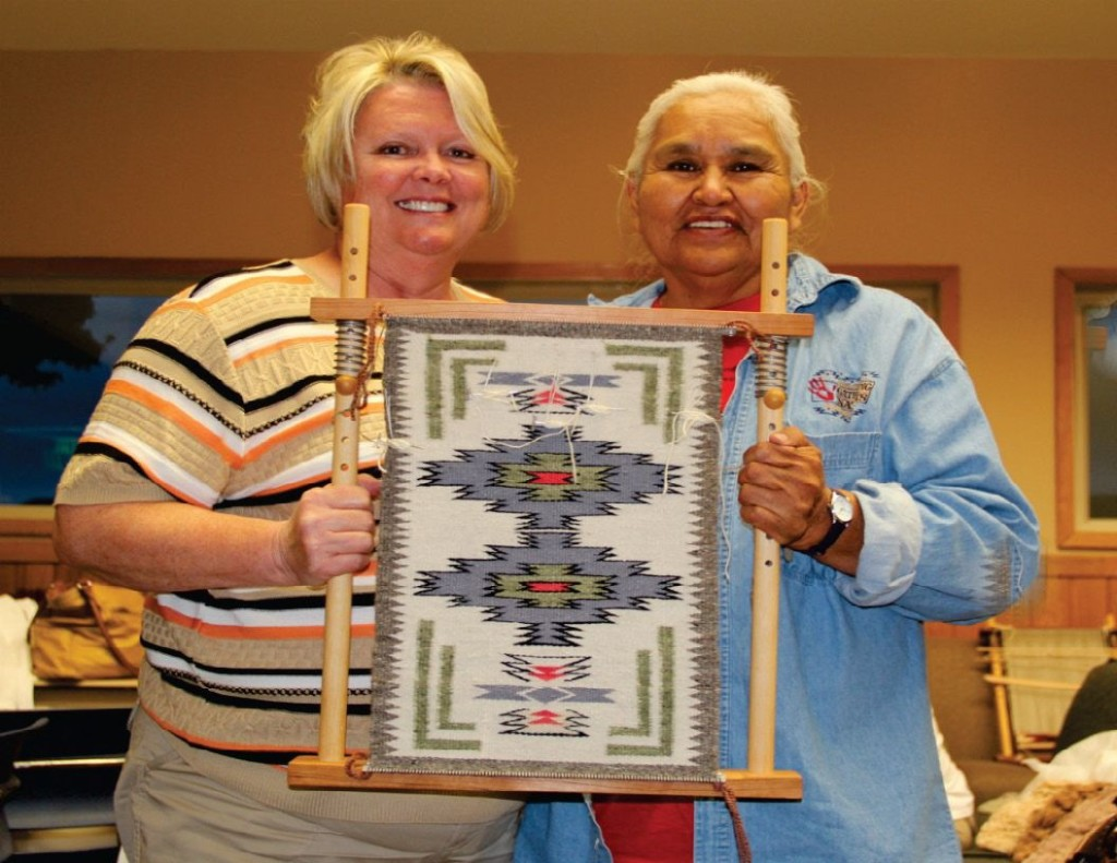 Navajo weaver, Jennie Slick (right), teaches students Navajo-style weaving using Caroline's handmade looms.
