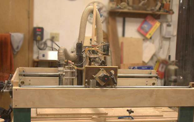 "Here's Dennis' ""Ace hardware CNC router."" Yes, he made it himself with parts from here and there and Ace Hardware. It obviously does a great job as you can see in the intricate bas relief carvings and engraving on his plaques."