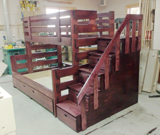 "Here's one of Edwin's elaborate, ""double decker"" bunk beds. Might just make kids (and parents) look forward to bedtime."