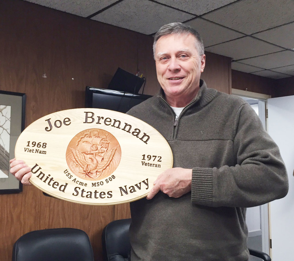Here's our man Joe Brennan, head of sales at Woodmaster. Joe was surprised and very pleased when he received the service plaque Dennis made for him.