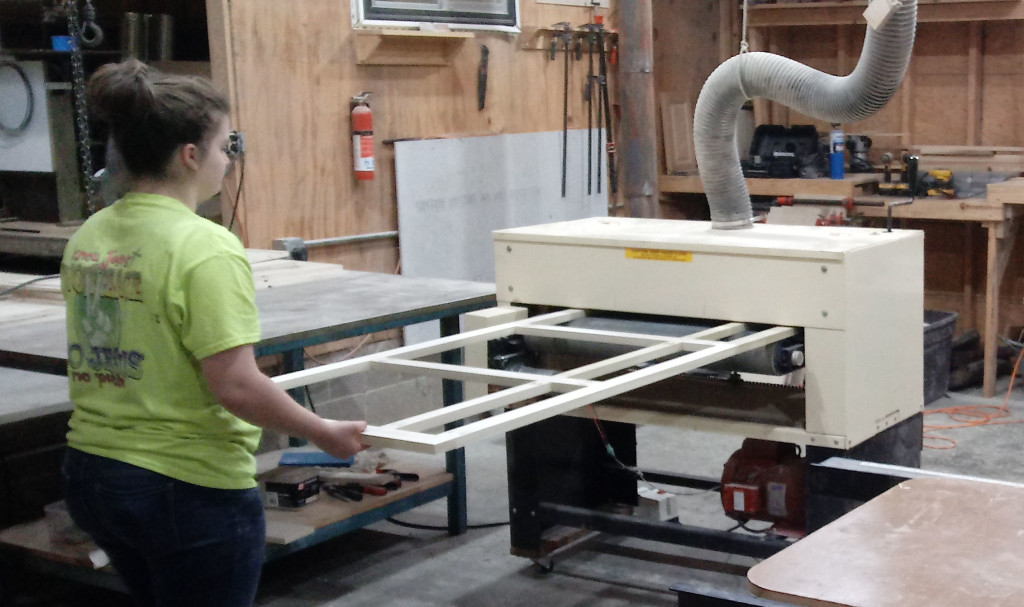 Daughters, too, get involved in Ray's family furniture business. Here's Destinee running a face frame through their Woodmaster Drum Sander.