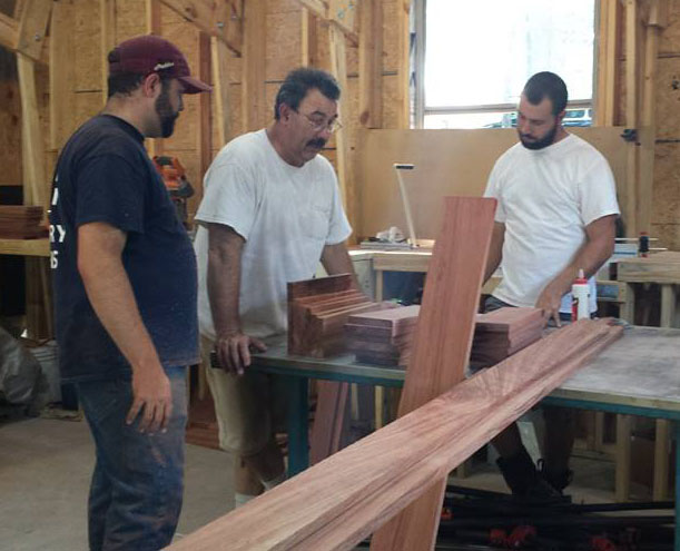 The father-and-sons Harmon team gets ready to tackle a New project. Left to right: Anthony, Ray, and Michael.