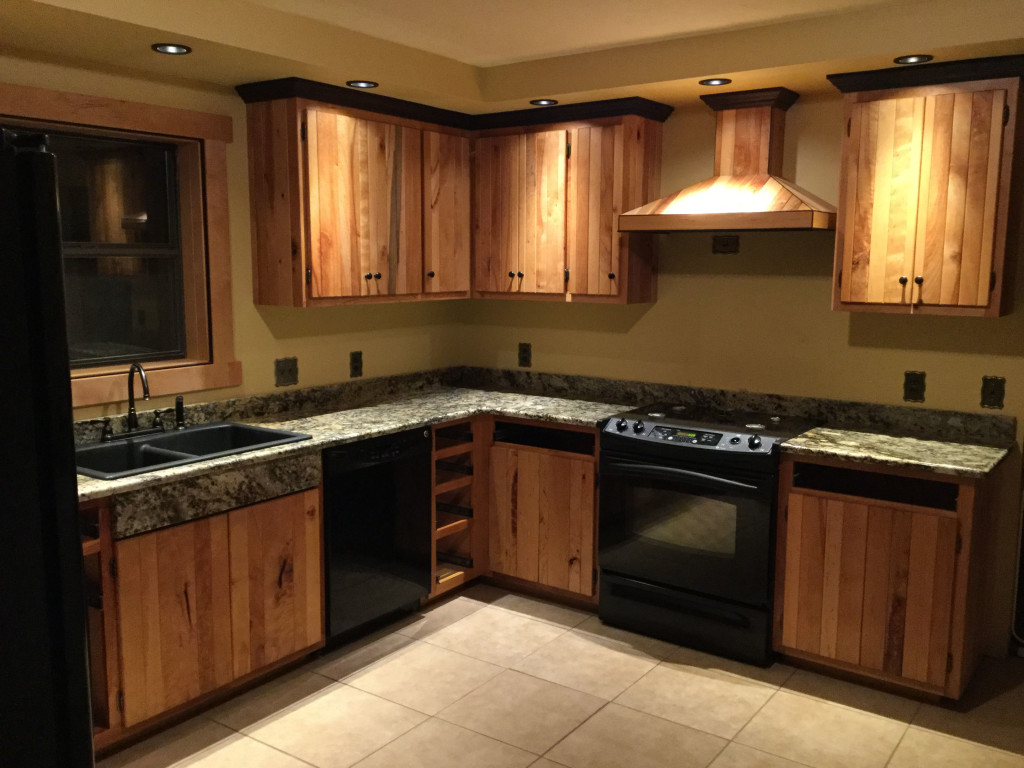Harmon Heirloom Furniture recently completed this handsome kitchen complete with tongue & groove Red River Birch, Wenge Trim, and granite counters.