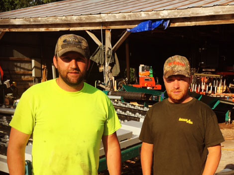 Matt (left) and his brother take a break from their family-owned logging business