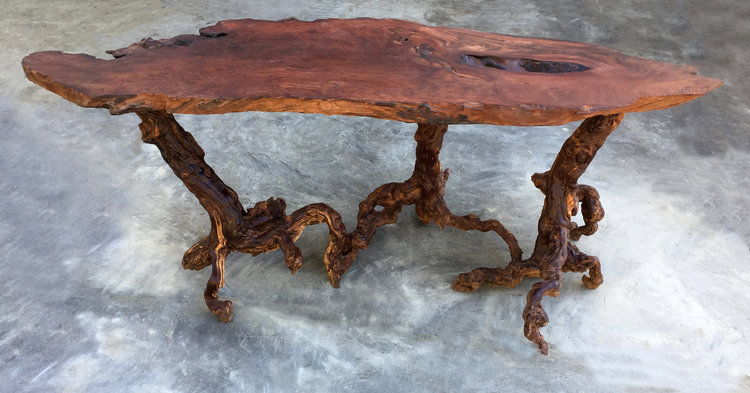 Matt emphasizes woods' natural beauty in his clean, sophisticated woodworking pieces like this live edge accent table