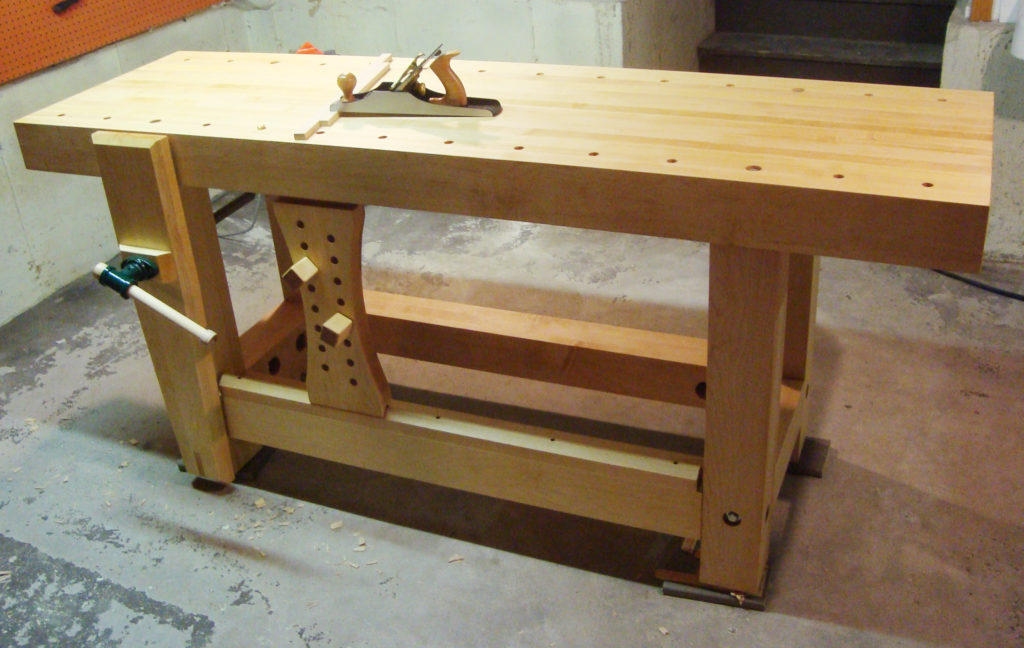 "The 24"" x 48"" maple workbench was made for a young couple currently living in a yurt. They use the wooden clamp mounted at one end to hold workpieces they're carving."