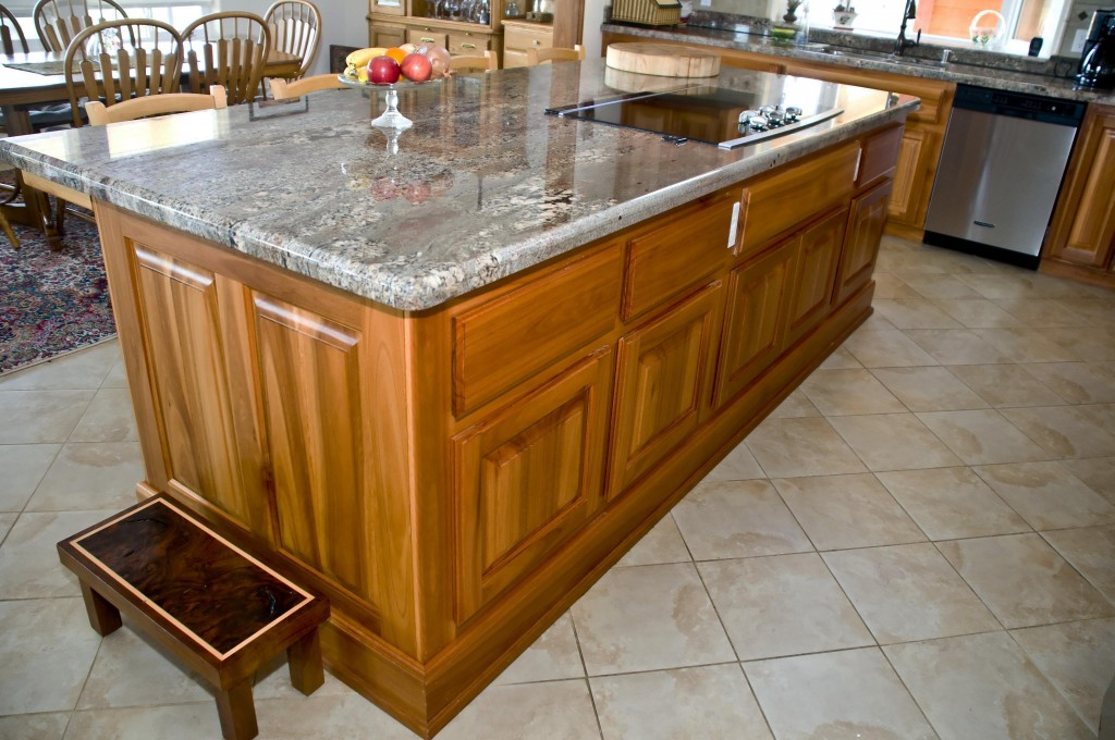 This gorgeous stone-topped kitchen island makes an outstanding focal point in this showcase kitchen. And it makes food preparation convenient, too. Note the fully functional sink. Photo by Donald's former student, Julie Prayer.