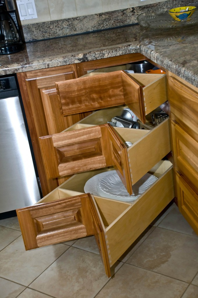 An outstanding kitchen like this one deserves more than the traditional lazy susan in the corner. Donald has maximized storage space while creating a unique and outstanding corner storage solution with angled drawer faces.