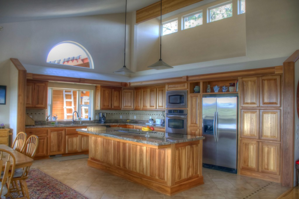 """Here's a spectacular example of Donald's work. """"I recently did this complete kitchen,"""" he tells us. """"The wood is all Australian Liptus. The homeowner wanted a natural finish to offset the decor of their home. I achieved this by using a 3 ml coat of conversion varnish."""""""