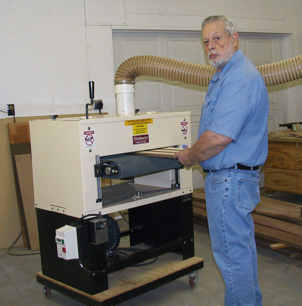 Here's Dennis in his show with his 2675 Woodmaster Drum Sander. That's where you'll often find him — some of his creations take 200 hours of shop time. Design time not included!