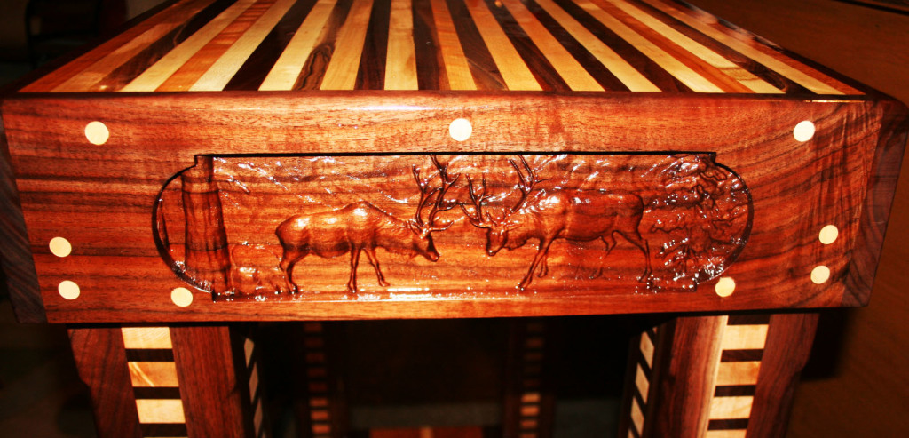 Wildlfe scenes like these are popular among the Yanney's customers. After sanding the wood perfectly flat and smooth with the Woodmaster, they carved this outdoor scene with their CNC router.