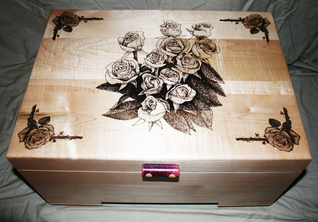 A beautiful jewelry box by the Yanneys. Woodmaster created the flat surfaces; their laser cutter created the floral designs.