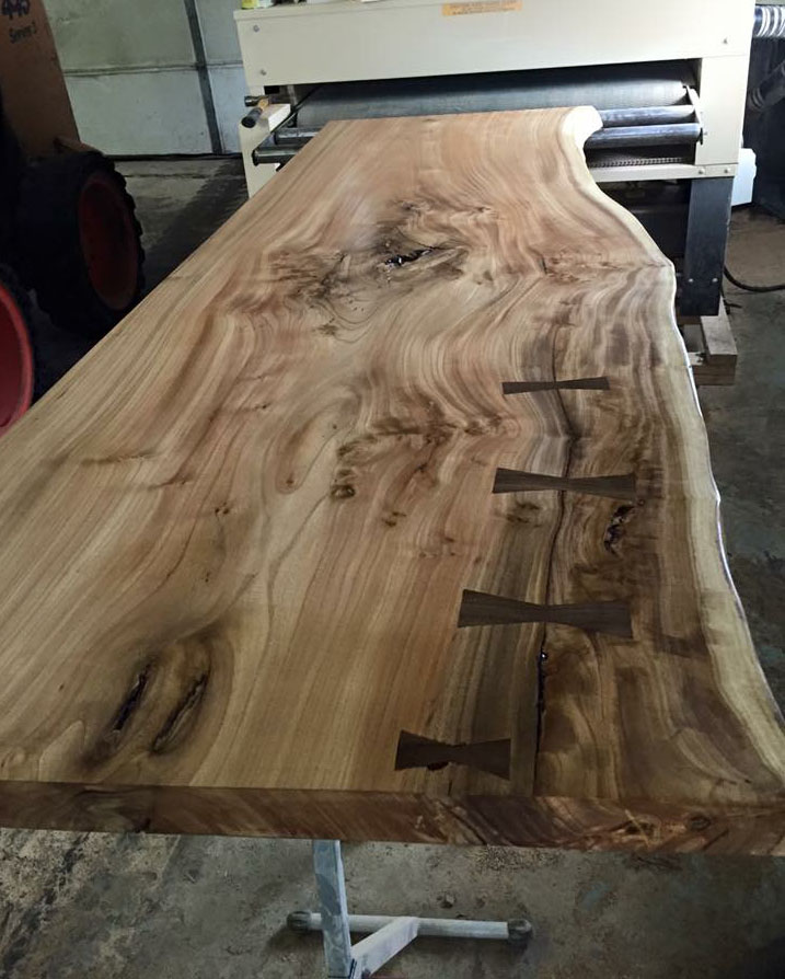 "Beautiful use of a butterfly joint as this solid hardwood slab exits Matt Collins' 50"" Woodmaster Drum Sander"
