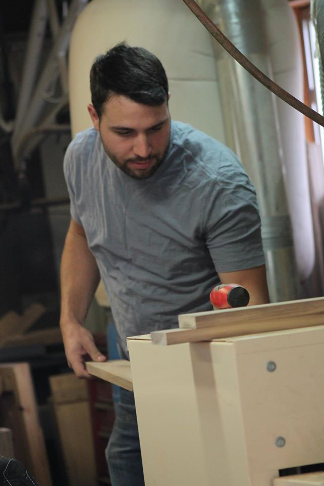 """Ray's son Michael running some stock down through the 38"""" Woodmaster Drum Sander."""