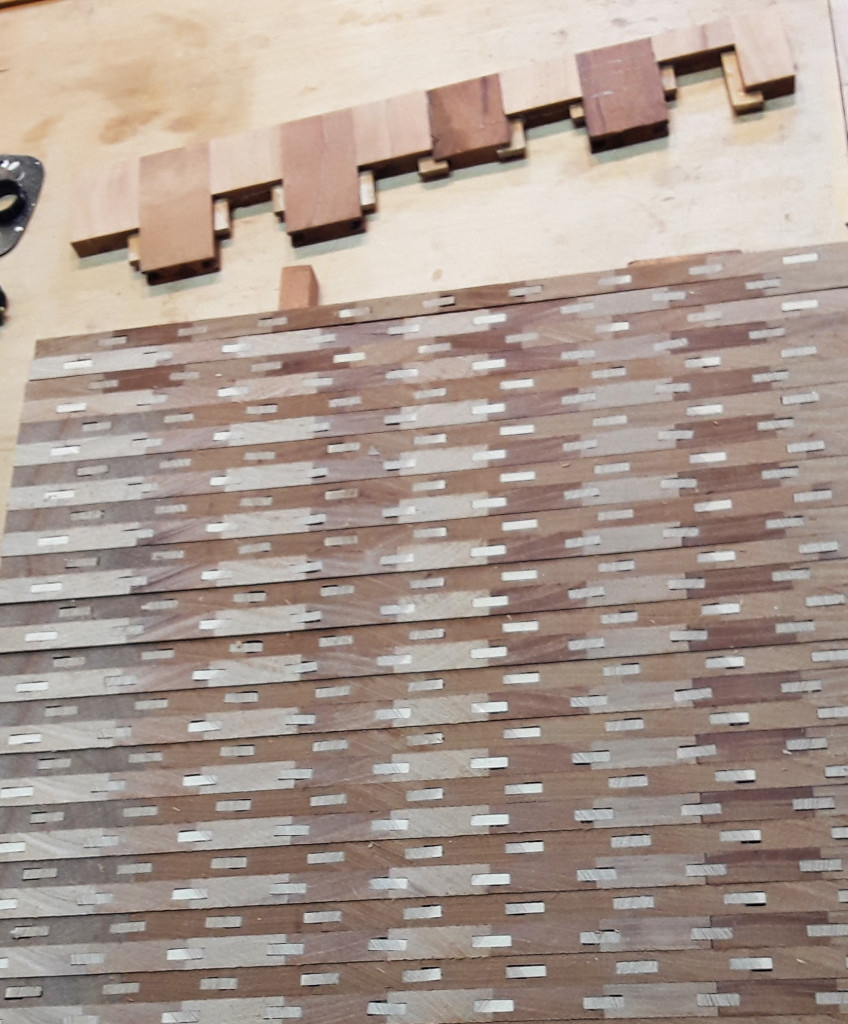 Check it out — Stuart saws the glue-up into strips, turns them on edge, and re-glues them to make his intricate patterns.