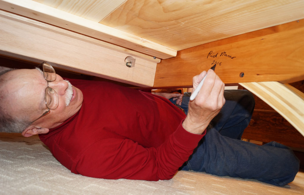 This photo was snapped as I crawled under the platform bed to sign and date the work at the owner's home.