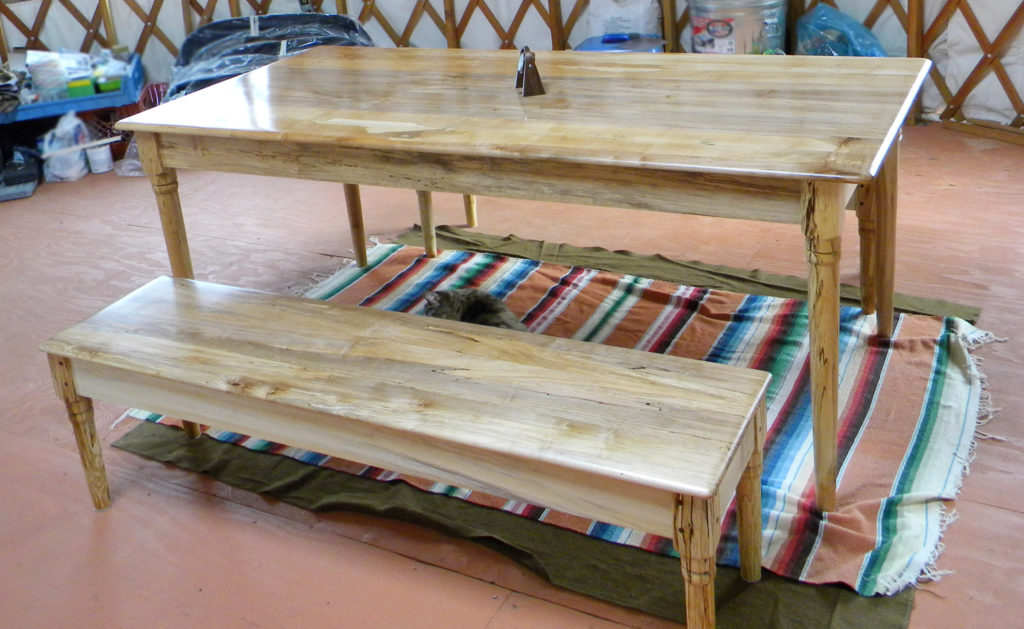 """The yurt couple also needed furniture, so I made a 40"""" x 70"""" table and matching benches out of some unique spalted maple. Finish is five coats of high-gloss tung oil; each coat is applied with 0000 steel wool."""