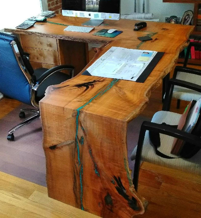 Here's a one-of-a-kind, L-shaped desk to die for. An epoxy resin fills the split, creating an accent that runs full length. Lacquer finish.